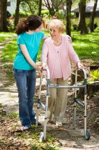 Young girl walking with an elderly lady, offering senior care in Scottsdale, AZ
