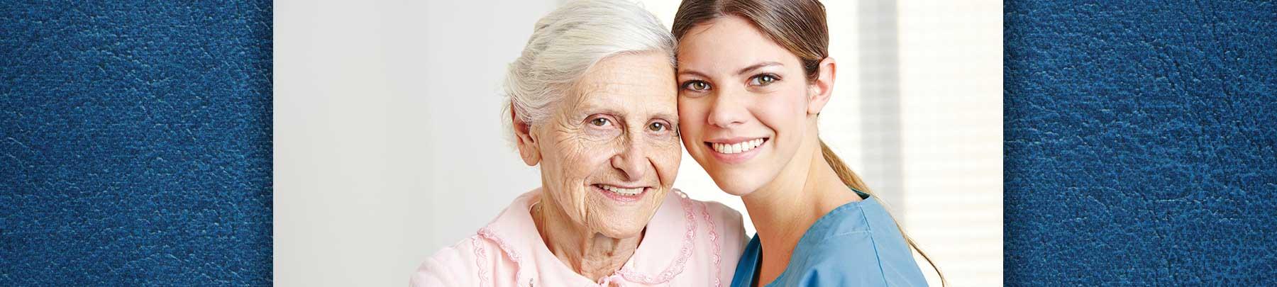 Senior with caregiver smiling at camera