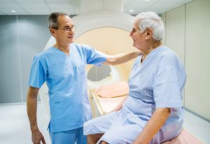Mature radiologist talking to senior patient