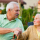 adult son caring for senior mother with dementia