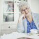senior woman smiling with a teacup