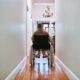 senior disabled man in wheelchair in hallway