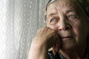 sad-senior-looking-longingly